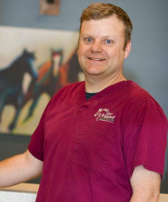 Dr. Travis Henry